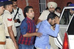 Vikas Barala (in blue shirt) being taken into police custody in Chandigarh on Wednesday.