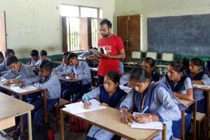 Navpreet Kumar teaching at Government Middle School at Sirsari village in Moga on Friday, August 12.
