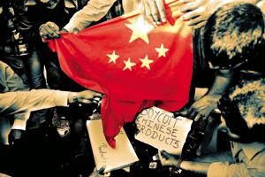 Citizens burn a Chinese national flag during a protest to boycott Chinese products in Ahmedabad after reports of alleged incursion by Chinese troops deep inside Indian territory.