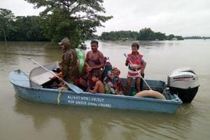 Border Security Force personnel evacuating stranded villagers in Alipurduar on Sunday.