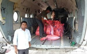 Food packets being loaded in a helicopter for airdropping among flood affected people in northeast Bihar.