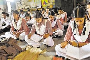 Students taking classes in a room that also serves as a library and science room at Government High School, Bhamian Kalan, in Ludhiana.