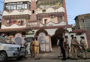 Securitymen stand guard outside the apartment in which the flat of the district welfare officer was raided in connection with the fund transfer scam, at Bhagalpur on Monday.