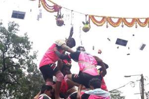 A govinda group tries to break a dahi handi in Thane.