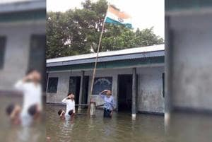 Four teachers and two students assemble to mark Independence Day in Naskara Lower Primary School in Dhuburi, Assam on August 15.