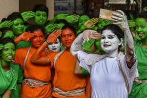 College students take a selfie as they get ready Independence Day celebrations in Matunga on Monday.