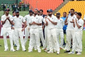 Indian cricketers react during the presentation ceremony after victory on the last day of the third and final Test against Sri Lanka at the Pallekele International Cricket Stadium.