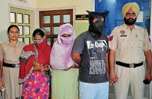 The victim's wife, mother and brother in police custody in Ludhiana on Monday.
