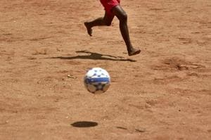 Photos: Barefoot, for the love of football at Independence Day Cup