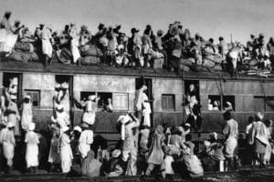 People migrating to Pakistan sit on the roof of an overcrowded coach railway train near New Delhi on September 19, 1947, a month after Partition.