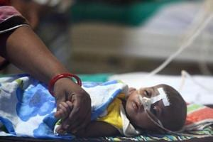 A file photo taken on August 14, 2017 shows a child at the encephalitis ward of the Baba Raghav Das Hospital in Gorakhpur, where 70 children died last week.