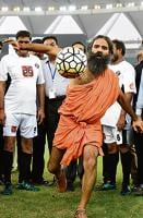 Kicking it: Baba Ramdev during a charitable football match between Indian Bollywood actors and Indian Parliamentarians in New Delhi on July 24, 2016.