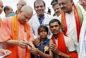 UP Chief Minister Yogi Adityanath with State Health Minister Siddharth Nath Singh at the inauguration of Japanese Encephalitis eradication drive at Musahar village in Kushinagar district