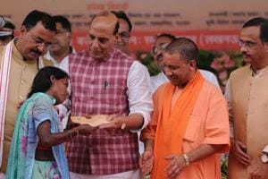 Adityanath and union home minister Rajnath Singh distributed certificates to farmers in keeping with the BJP's assembly election promise.