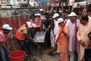 Uttar Pradesh chief minister Yogi Adityanath takes part in a cleanliness drive in Gorakhpur on Saturday.