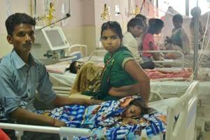 Children receive treatments at the Baba Raghav Das Medical College Hospital, Gorakhpur