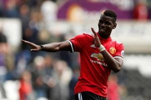 Manchester United hit four again as Liverpool scrape first win against...