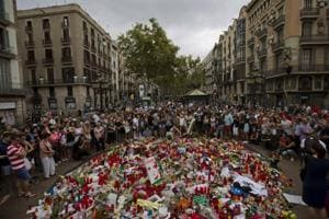 'We aren't afraid': People in Barcelona pay tribute to victims of...