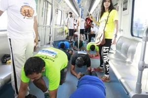 Fitness enthusiasts take the plank challenge on a moving metro in Gurgaon.
