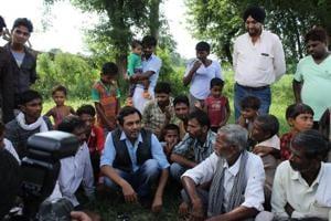 Nawaz interacting with Raja Khera villagers (Lucknow outskirts).
