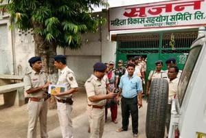 A police team at the Srijan Mahila Sahyog Samiti office in Bhagalpur.