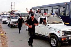 Security forces during a flag march in Sirsa on Monday.