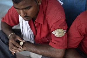 Photos: For Indian Railways coolies changing times mean dwindling...