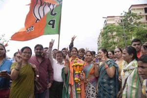 BJP workers celebrate after the results.