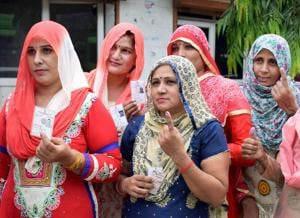 Women show their ink-marked fingers after casting votes for Bawana assembly seat byelection on Wednesday.