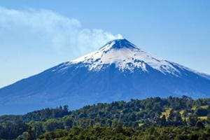 Take an offbeat trip. Visit a mammoth active volcano in Chile