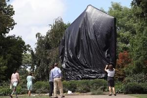 Charlottesville covers Confederate statues in black drape