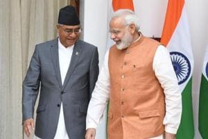 Prime Minister Narendra Modi and his Nepali counterpart Sher Bahadur Deuba (left) arrive for a meeting and agreement signing ceremony in New Delhi on August 24, 2017.