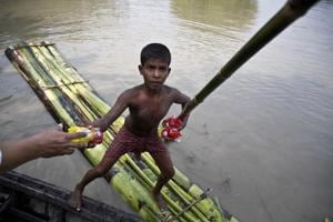 Photo: Assam floods force daily life to resort to boats