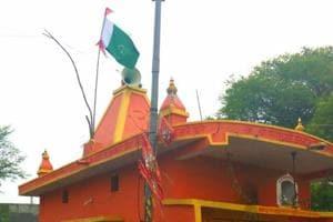 Tension grips a Madhya Pradesh's Narsinghpur town after a 'Pakistani flag' was found atop a Hanuman temple.
