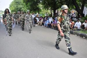 Security personnel conduct a flag march in Panchkula's Sector 5 on Friday.