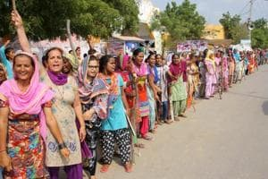 Followers of Dera Sacha Sauda head Gurmeet Ram Rahim  gather at the sect's Sirsa headquarters on Thursday, a day before the CBI court is expected to deliver its verdict.
