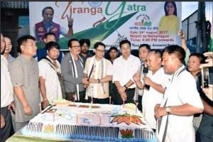 Union minister Kiren Rijiju along with two other ministers cut the cake during a function on Thursday to flag off Tiranga Yatra, organised by Bharatiya Janata Yuva Morcha.