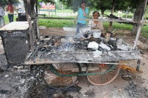 A roadside vendor shows her cart that was burnt by Dera Sacha Sauda followers during violence after the verdict against Gurmeet Ram Rahim Singh in Panchkula on Friday.