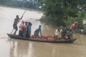 Vendors ferrying LPG cylinders on boat in a flood-hit area of Bihar.