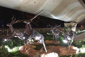 Sculptures and greenery beneath the Lajpat Nagar flyover.