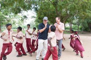 Matt Damon and Gary White with school children in India.