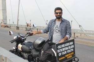 Shrawan Kumar Yadav with his bike on Allahabad's New Yamuna bridge.