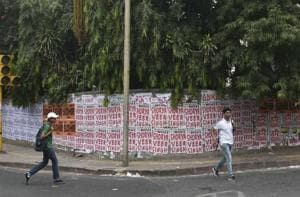 Names of ABVP and NSUI candidates can be seen scribbled on walls in huge bold letters and on posters pasted across the city.