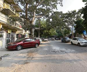 The report states that due to glaring design flaws in road design, the rain run-off often floods housing societies.