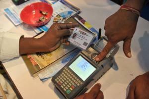This file photo shows a visitor giving a thumb impression to withdraw money from his bank account with his Aadhaar or Unique Identification (UID) card during a Digi Dhan Mela, held to promote digital payment, in Hyderabad.