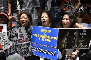 Protesters in Delhi shout slogans in support of their demand for a separate Gorkhaland. Protests have taken place in many cities across India.