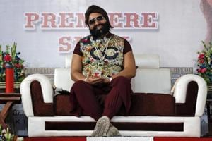 "In this May 17 file photo, a self-styled godman Gurmeet Singh Ram Rahim Singh attends the premier of the movie ""Jattu Engineer"" in New Delhi"