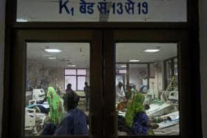Children receive treatment at Baba Raghav Das Medical College Hospital in Gorakhpur, Uttar Pradesh.