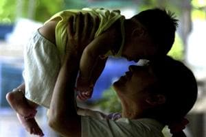 A mother plays with her son in Bangkok.