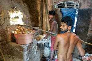 A fresh batch of poi (pav) emerges from a traditional bakery in Merces, about 7 km from Panaji.